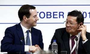 George Osborne, left, and Lou Jiwei of China attend a finance ministers' meeting in Lima, Peru.