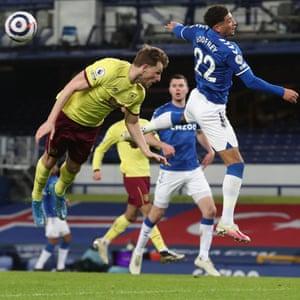 Ben Godfrey of Everton diverts the ball away from Chris Wood of Burnley.