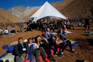 Chileans watch the sky prior to a total solar eclipse in Paiguano, Chile.