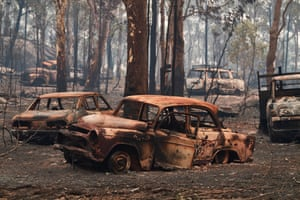 Burnt cars in forest after fires in Sydney, Australia
