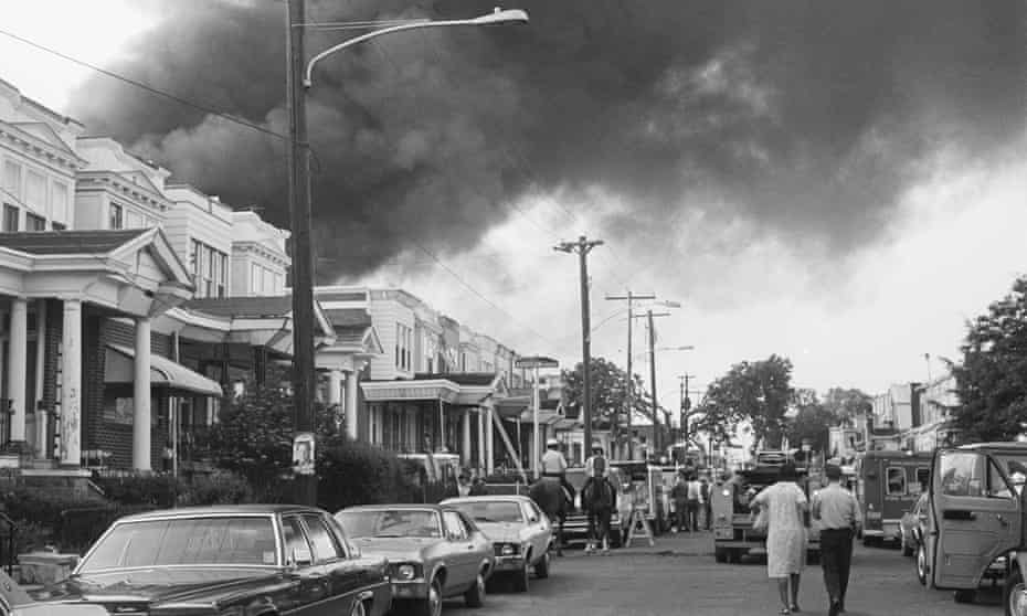 Smoke billows over rowhouses in West Philadelphia after the 1985 bombing.