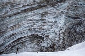 A tourist poses for a picture on the Bogdanovich glacier