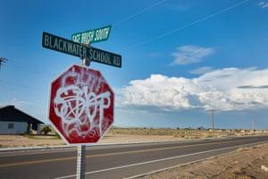 Stop sign covered in graffiti, Blackwater, Arizona