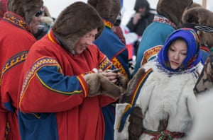 Participants from Nenets Autonomous Okrug are seen during a reindeer race on the Reindeer Herders Day