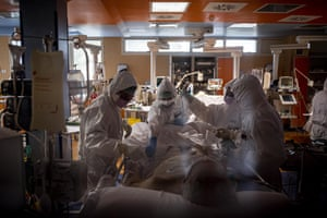 Doctors treat Covid-19 patients in an intensive care unit at a Covid Hospital in Rome, Italy.