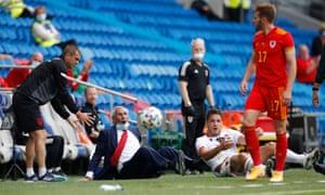 Albania coach Edoardo Reja and Bekim Balaj react after being pushed over by Wales' Rhys Norrington-Davies.