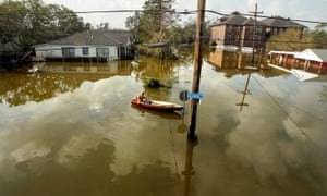 A man rides in a canoe in high water after Hurricane Katrina on August 31, 2005 in New Orleans, Louisiana.
