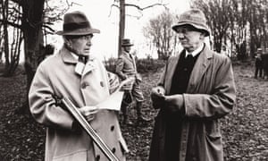 James Mason, with a gun, and John Gielgud in a scene from Alan Bridge's film The Shooting Party, set in 1913.