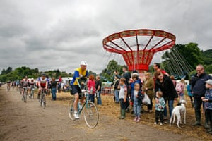 Spectators are there to greet the riders as they enter the festival site