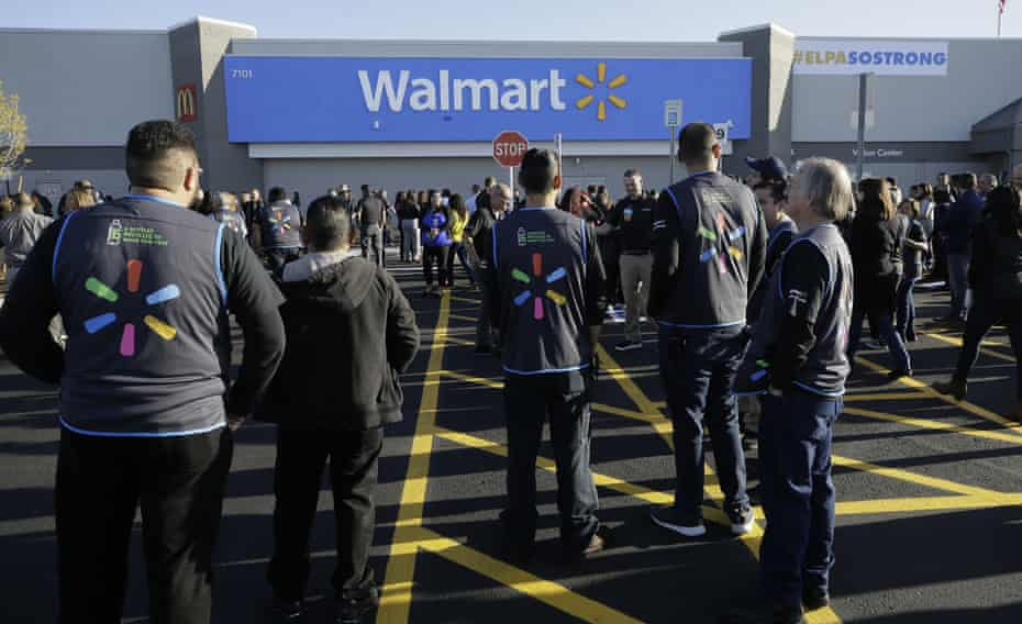 Walmart employees gather outside the El Paso store for the reopening, three months after a deadly shooting.