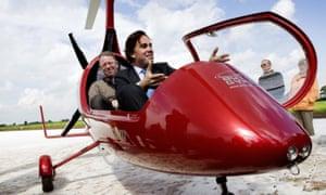 The then Dutch transport minister Camiel Eurlings (2-L) and engineer John Bakker sit inside the Pal-V vehicle following a test flight in 2009.