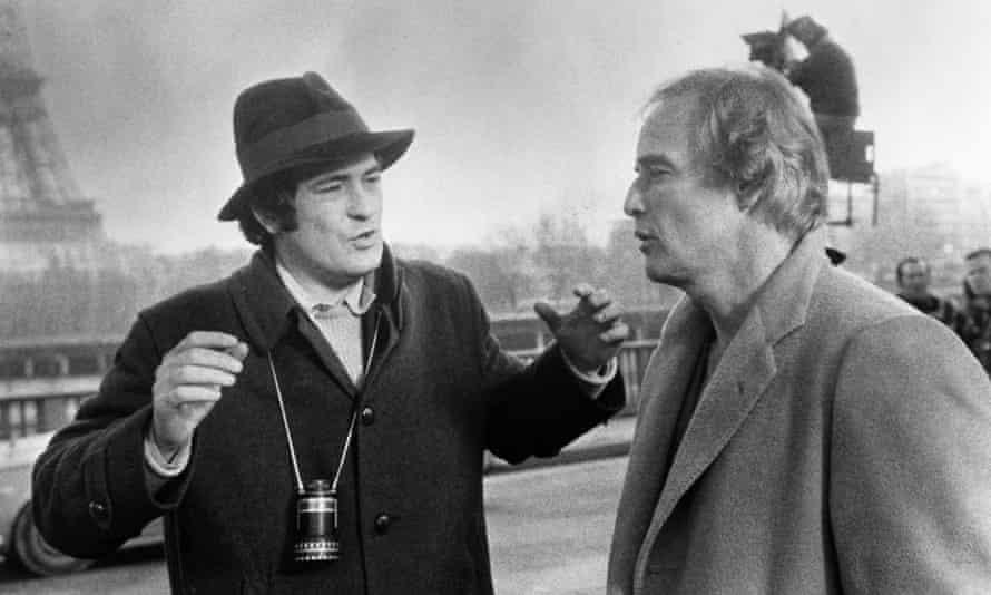 Bernardo Bertolucci, left, with Marlon Brando while filming Last Tango in Paris in 1972.