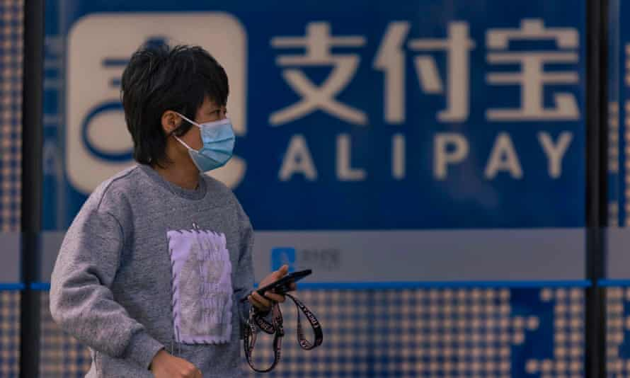 A woman walks in front of the Alipay building in Shanghai, China