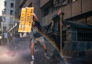 Cape Town, South Africa: water cannon are used in an attempt to disperse a gathering of hospitality workers who were peacefully protesting against the current lockdown regulations