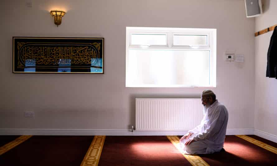 A man praying in Noor Ul Islam mosque in Bury, Greater Manchester in April 2020.