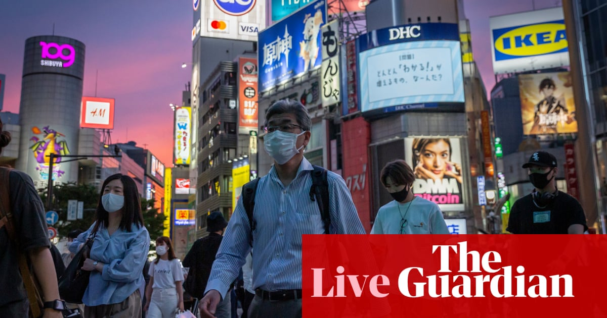 Coronavirus live news: US reaches 70% first-shot goal while Japan shifts to home care for most Covid patients