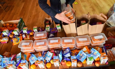 A volunteer preparing free packed lunches for children in Bristol.