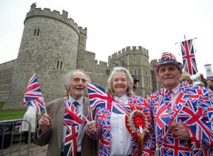Royal supporters pose for pictures as they gather outside Windsor Castle