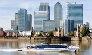 A Thames Clipper passing Canary Wharf