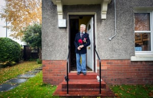 Bomber command veteran Alastair Lamb, 95, observes a two-minute silence at 11am on Remembrance Sunday from his doorstep at his home in Stirling