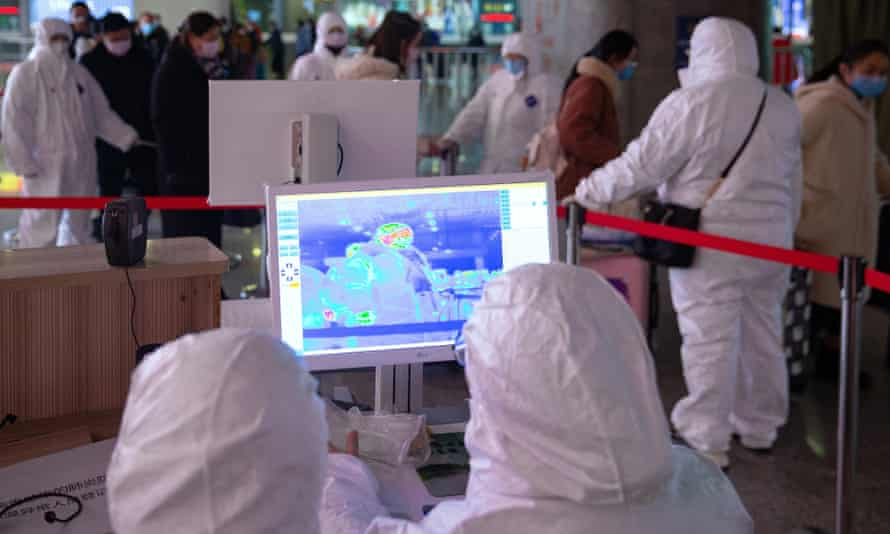Medical infrared thermal imaging is used to check the temperature of rail passengers in Nanjing, where the World Indoor Championships were due to be held.