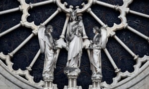 A view shows statues of the western rose window of Notre-Dame Cathedral.