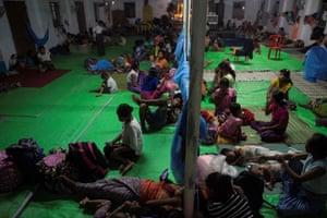 Rakhine children take rest at a temporary shelter in Sittwe, Rakhine State