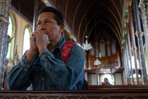 Raul Oporta, 53, praying inside La Merced church in San José.