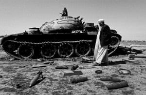 A man is seen next to a tank outside Kirkuk in 2003