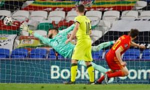 Wales' Daniel James scores their first goal.