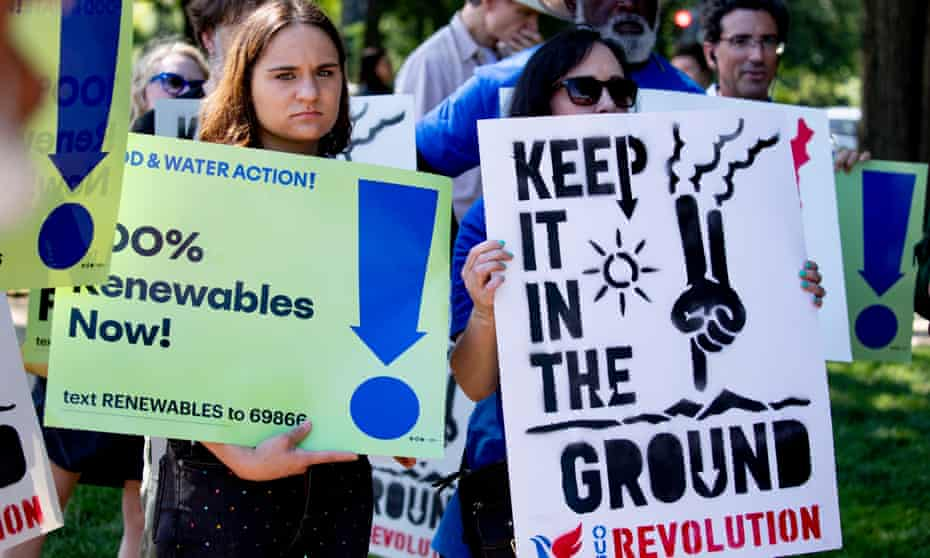 Activists in Washington DC demand an end to fossil fuel subsidies on 29 July. Progressives are calling on the Biden administration to use the infrastructure bills to dramatically transform the US energy sector.