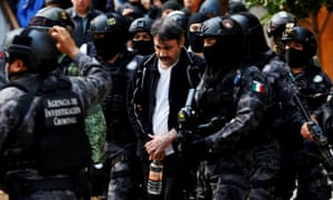 Dámaso López is escorted by police officers in Mexico city on 2 May 2017.