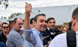 South Australia's Liberal Leader Steven Marshall gives a thumbs up to a voter at a polling station in Adelaide