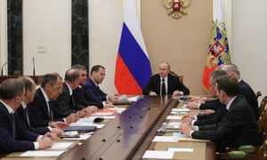 Russia's President Vladimir Putin holding a meeting of his security council at the Kremlin to discuss Russia's response to the expulsion of 23 Russian diplomats from London.