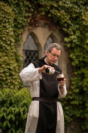 Father Joseph pours himself a glass