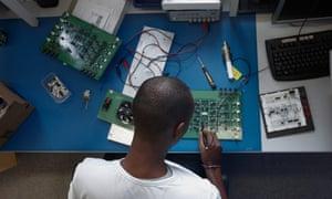 man programming computer at desk