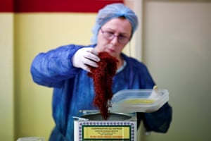 A worker holds dried saffron stigmas at the Cooperative of Saffron premises in Krokos, Greece