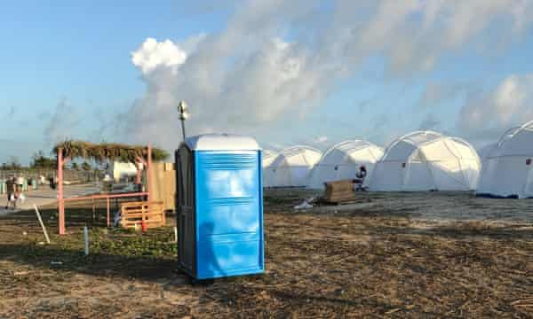 tents and a portable toilet set up for attendees for the Fyre Festival