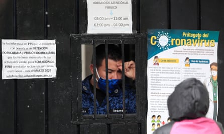 A prison guard talks to a woman at the main entrance of the Villavicencio prison in Bogotá on 8 May.