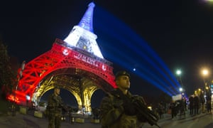A French soldier in front of the Eiffel Tower the day after the attacks.