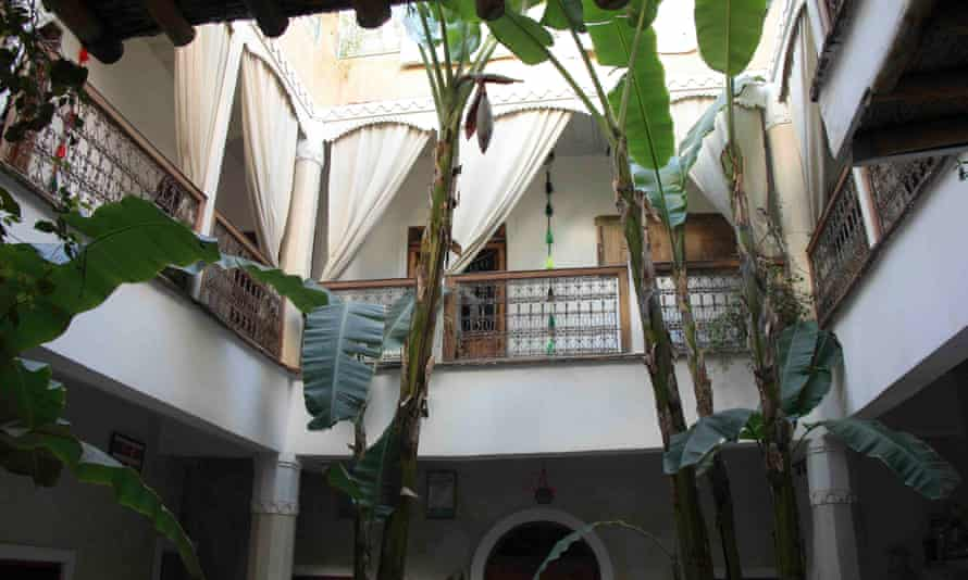 View from the courtyard looking up to patio rooms at Chambres d'Amis, Marrakech, Morocco.