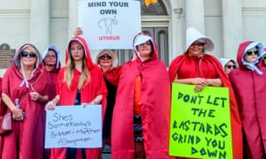 Activists dressed as handmaids protest the abortion ban in the French Quarter of New Orleans, Louisiana, on 25 May.
