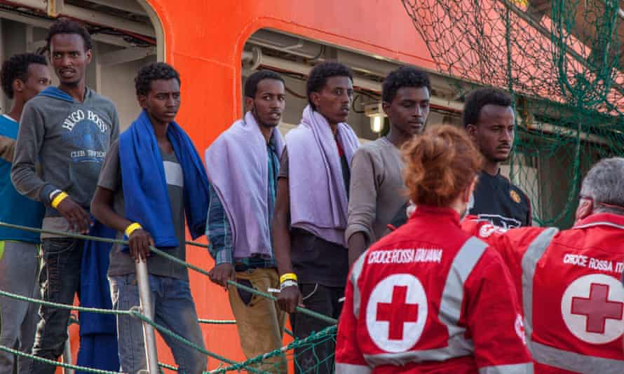 Migrants arrive in Palmero after being rescued by a Norwegian ship in the Mediterranean.