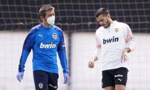 The Valencia manager, Albert Celades (left), takes training on Monday. The La Liga clubs are largely back on the training ground - in small groups under the strictest regulations.