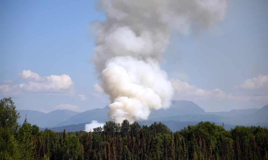 Smoke rises from a wildfire south of Talkeetna, Alaska, in 2019