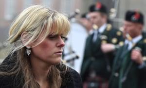 Jen Phillips arrives at her husband's funeral