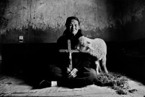 Old woman with lamb, holding a cross. Shaanxi, 1992 from 'On the Road'