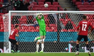 England keeper Jordan Pickford punches clear.