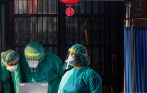 Medical staff at one of the rapid test stations in Wanhua District.