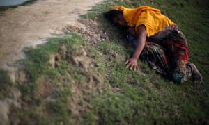Rohingya refugee lies on the ground